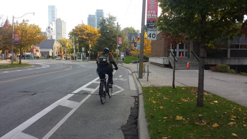 Cyclist riding in a buffered bike lane