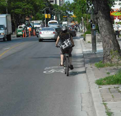Image shows a rider in a sharrow