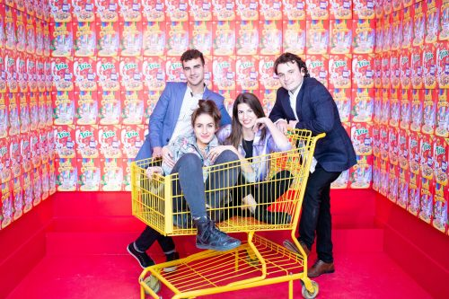 Photo credit: D. Horvath Photography. People in shopping cart surrounded by boxes of cereal,