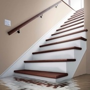 Basement stairs with water pooling at the bottom of them.