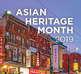 Building with multiple Asian signs. Asian Heritage month image.