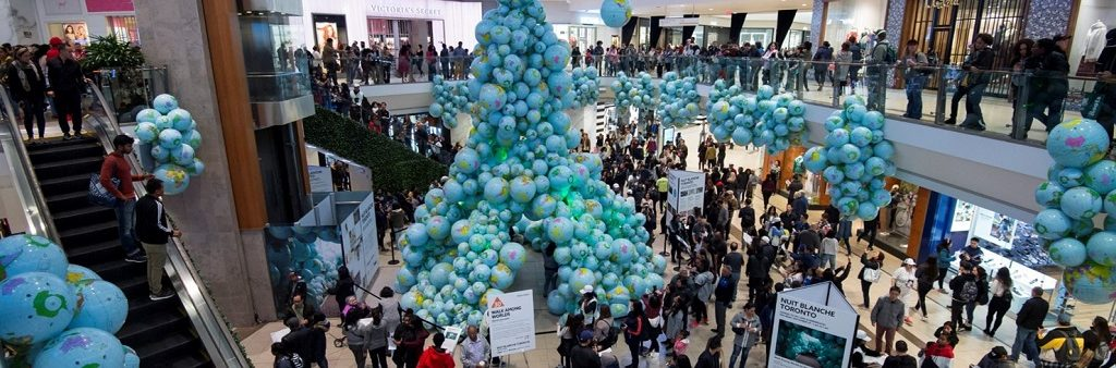 Art installation in Scarborough Town Centre's centre court consisting of a tower of inflated globes of varying sizes. Additional inflated globes are affixed to the mezzanine overlooking the court.