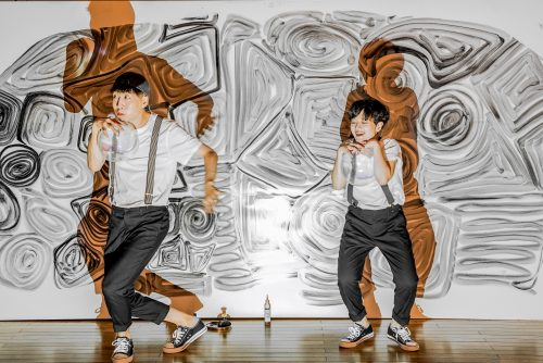 two people dancing. black, white and orange background