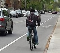 Images shows a rider in a bike lane