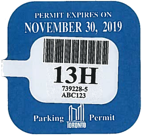 A blue parking permit renewal sticker reading: Permit Expires November 30, 2019