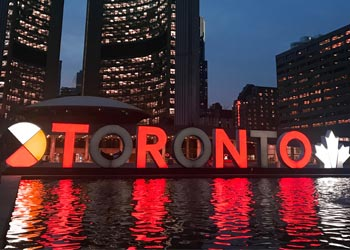 The Toronto Sign in Nathan Phillips Square at night illuminated in the Black and red colours of the Toronto Raptors