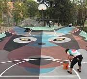 Basketball court painted as a mural.