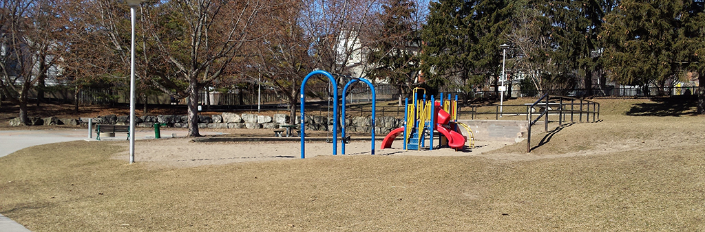 A brightly coloured playground at Kempton Howard Park, with a slide, swings and climbing areas.