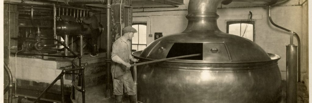 Archival image of a brewmaster making beer in the 1800s