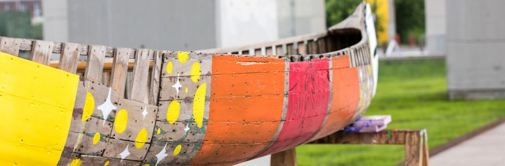 Colourfully-decorated wooden canoe