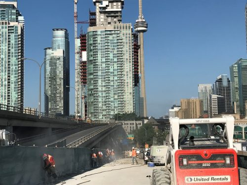 Image of westbound Gardiner Yonge-Bay-York off-ramp work zone, image of crews chipping concrete on the southside of the ramp.