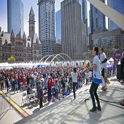 """Guests and dancers participate in the """"Welcome Gesture,"""" a dance activity which marked the official opening of the Newcomer Day Main Stage Program"""
