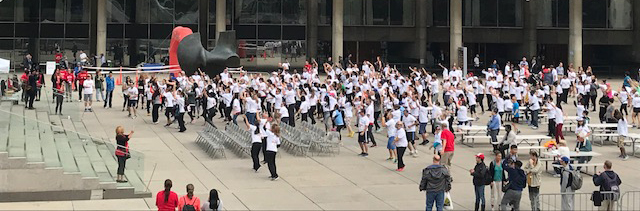 City staff warm up in Nathan Phillips Square before a 5 km fundraiser run for the United Way.