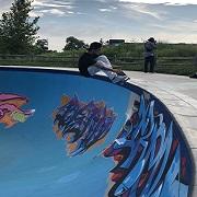 Skateboarder performing on newly painted Ashbridges Bay Skatepark