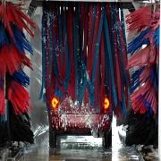 Car going through soft cloth automated carwash