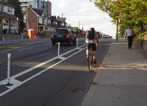 separated bike lane on the road with flexi-posts
