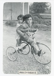 Children Mavis and Dennis Chu on a tricycle. Image courtesy of Mavis Garland.