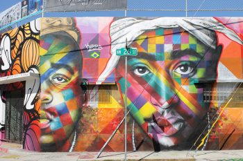 A colourful street mural of artists Tupac Shakur and Biggie.
