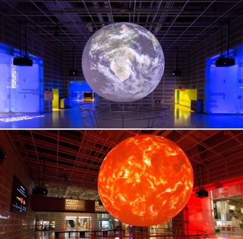 stacked image of the exhibit. Planet at centre -top, it is grey and white; bottom, it is orange and yellow