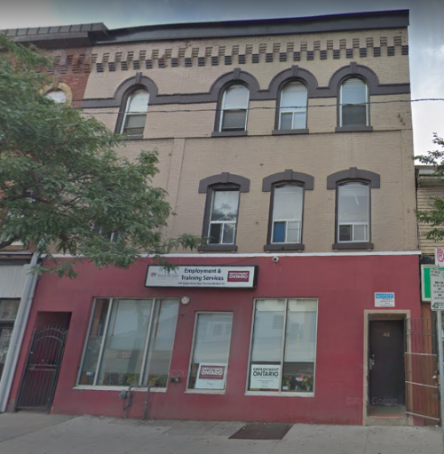 A three storey building at 250 Queen St E