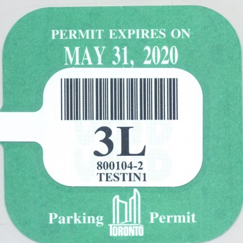 A green parking permit renewal sticker reading: Permit Expires May 31, 2020