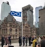 Métis flag on flagpole at City Hall.