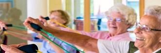 Seniors using exercise equipment in a Senior Centre recreation room