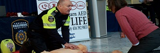Paramedic demonstrating AED during a training session