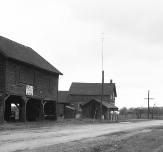 Grayscale photo of Keele Street and Finch Ave in 1955, with dirt roads and historical properties