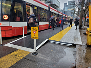 A raised transit platform on King Street at a streetcar stop