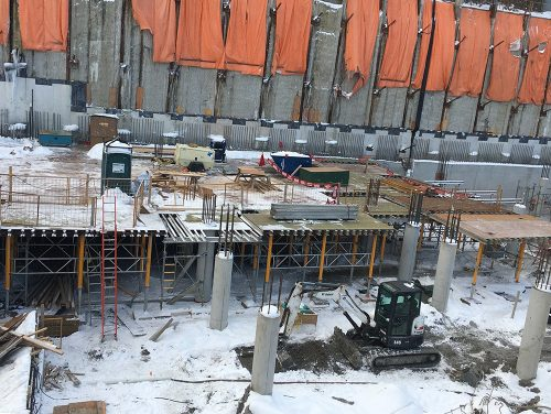 Snow covers much of the garage construction site at Bessarion Community Centre.