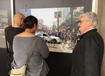 Photo Laureate Geoffrey James explains a photograph to viewers during his Doors Open Toronto show at City Hall in 2017