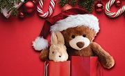 Holiday-themed flyer featuring cute stuffed bear with Santa hat