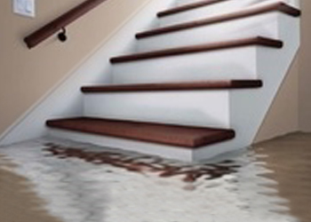 Stairs leading to flooded basement