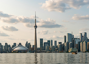 view of the CN Tower and waterfront from Toronto Island Park.