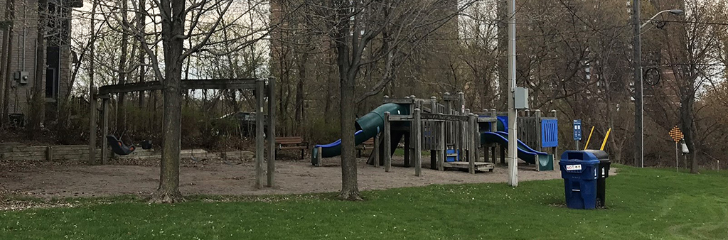 The current playground at Acacia Park, including the slides and climbing equipment.