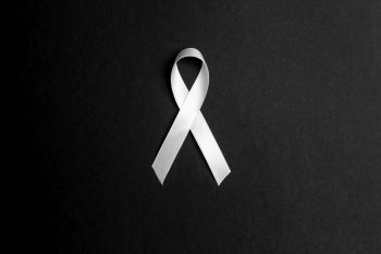 Image of a white ribbon symbolizing of anti-violence against women