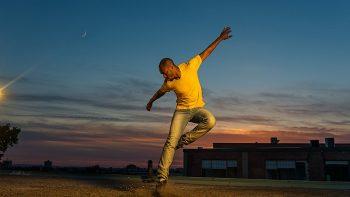 Travis Knights dancing at dusk