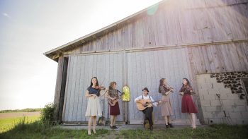 Members of the Ontario-based band, Ariko, in front of a barn.