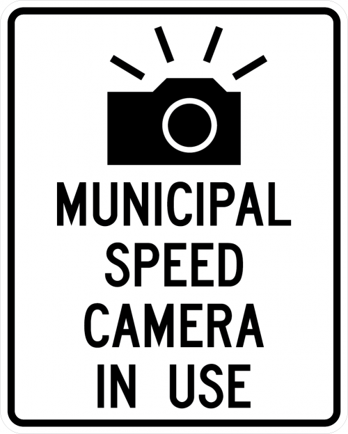 Black and white street sign that reads Municipal Speed Camera in use