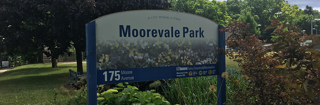 The Moorevale Park sign post, surrounded by a garden.