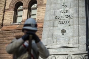 This is an image of the Sentries in position at the Old City Hall Cenotaph during Remembrance Day