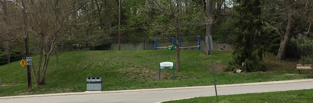 Cashman Park, with the park sign out front and playground equipment and swings in the back.