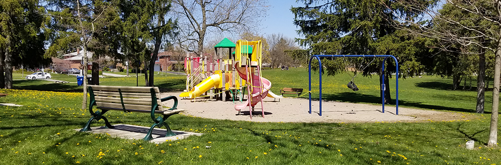 Old Sheppard Park playground with slide and swings