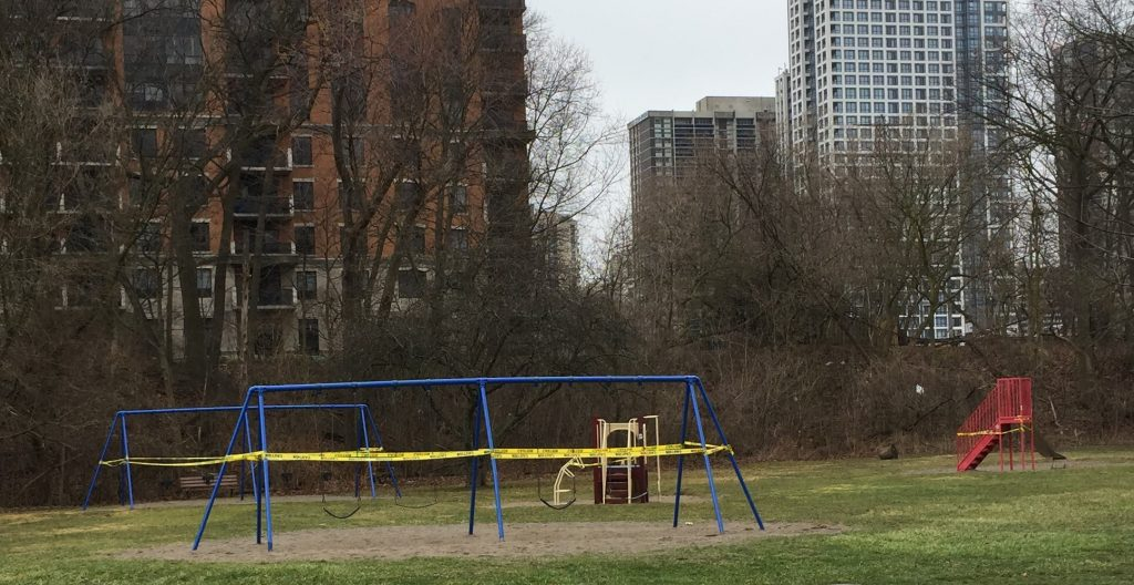 Tom Riley Park playground in 2020, with swings and other playground equipment taped off due to COVID-19