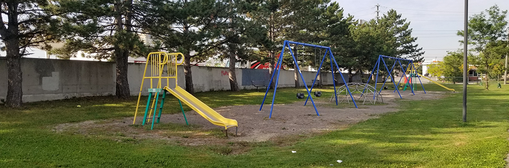 A photo of the current and old playground at Frost Park, with slide and swings.