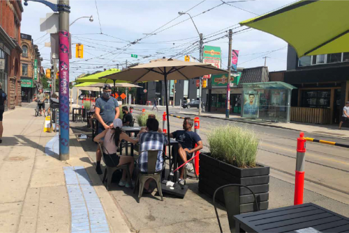 Curb lane being used as a patio for CafeTO.
