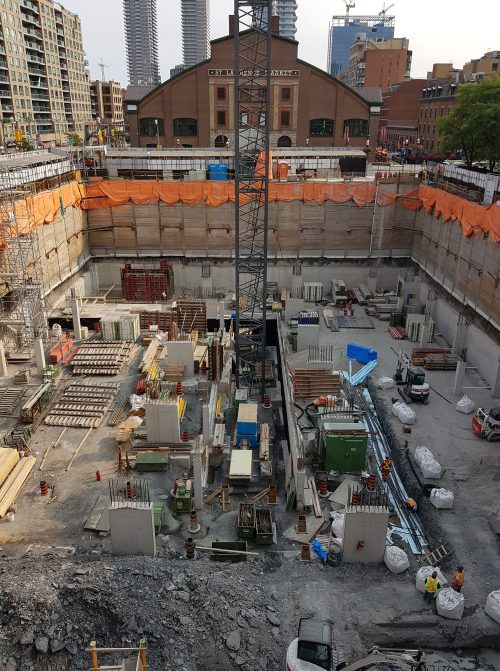 Parking Level 4 perimeter foundation walls and interior columns nearing completion. Underground geothermal system ongoing.