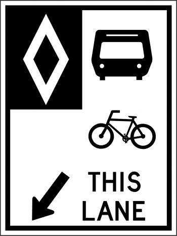 Black and white street sign indicated that only buses and bikes are allowed in the lane.