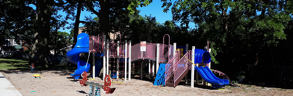 A photo of the playground at Norwood Park. It includes climbing equipment and slides.